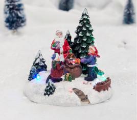 Village lumineux - Père Noël distribution cadeaux